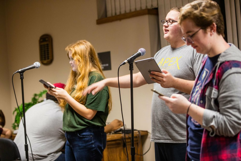 Beka Wright (from left) as Concealed Carrie; Caleb Foshe as Professor Anders and recording technician Tamsen Clayborn during an episode of Concealed Carrie, the radio drama/comedy produced by the Arkansas Radio Theatre and the Arkansas Tech University Department of Communication and Journalism. (Arkansas Tech University/LIZ CHRISMAN)