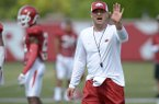 Arkansas assistant coach Barry Lunney Jr. directs his players Thursday, Aug. 9, 2018, during practice at the university's practice facility in Fayetteville.