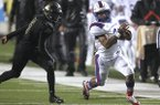 Arkadelphia running back Kyren Harrison (2) races around Robinson safety Mekel Kentle (16) for a 35-yard touchdown run in the fourth quarter of Arkadelphia's 28-0 win in the Class 4A state championship game on Saturday, Dec. 8, 2018, at War Memorial Stadium in Little Rock.