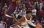 Arkansas guard Isaiah Joe (1) drives around Texas Southern's John Walker III during a game Tuesday, Nov. 19, 2019, in Fayetteville.