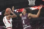 Arkansas' Isaiah Joe goes up for a shot as Texas Southern's Bryson Etienne defends during a game Tuesday, Nov. 19, 2019, in Fayetteville.