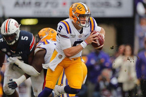 LSU quarterback Joe Burrow (9) scrambles in the first half of an NCAA college football game against Auburn in Baton Rouge, La., Saturday, Oct. 26, 2019.