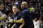 Nevada head coach Eric Musselman, center, is held back by assistant coach Johnny Jones, right, as he yells at game official Tommy Nunez, center left, after an NCAA college basketball game against San Diego State Saturday, March 3, 2018, in San Diego. San Diego State won, 79-74. (AP Photo/Gregory Bull)