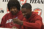 Davonte Davis signs to play basketball at the University of Arkansas while his grandmother Yvette Davis watches during a ceremony Tuesday, Nov. 19, 2019, in Jacksonville.