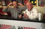 Arkansas interim football coach Barry Lunney Jr. (left) and Razorback football play-by-play voice Chuck Barrett are shown Wednesday, Nov. 20, 2019, at Catfish Hole restaurant in Fayetteville.