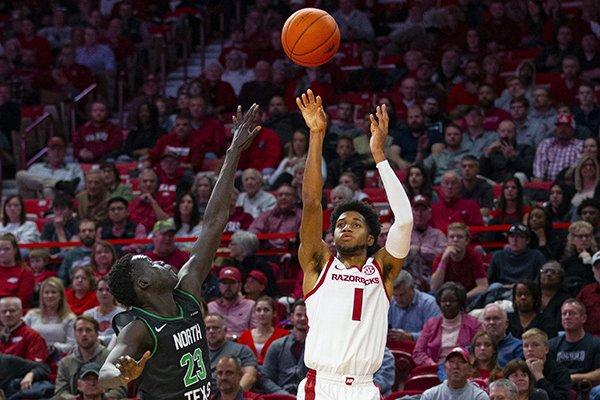 Arkansas' Isaiah Joe (1) shoots over the top of North Texas' Deng Geu during a game Tuesday, Nov. 12, 2019, in Fayetteville.