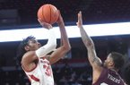 Jimmy Whitt shoots over a Texas Southern defender in Arkansas' 82-51 win over the Tigers on Tuesday, Nov. 19, 2019 at Bud Walton Arena in Fayetteville.