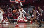 Arkansas' Isaiah Joe comes away with the ball against Texas Southern's Eden Ewing Tuesday Nov. 19, 2019 at Bud Walton Arena in Fayetteville. Arkansas won 82-51.