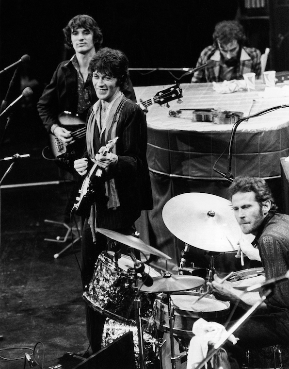 The Band (counterclockwise from top right), Richard Manuel on piano, Levon Helm on drums, lead guitarist Robbie Robertson and bass guitarist Rick Danko, take the stage for their final live performance before a crowd at Winterland Auditorium in San Francisco on Nov. 27, 1976. (AP)