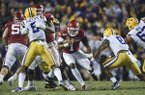 Arkansas quarterback KJ Jefferson (1) carries the ball during a game against LSU on Saturday, Nov. 23, 2019, in Baton Rouge, La.