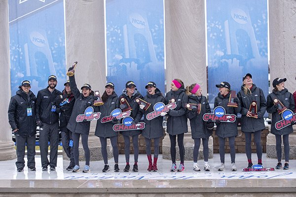 Arkansas runners celebrate after being presented their trophies for winning the women's NCAA Division I Cross-Country Championship, Saturday, Nov. 23, 2019, in Terre Haute, Ind. (AP Photo/Doug McSchooler)