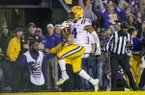 LSU running back John Emery runs for a touchdown during a game against Arkansas on Saturday, Nov. 23, 2019, in Baton Rouge, La.