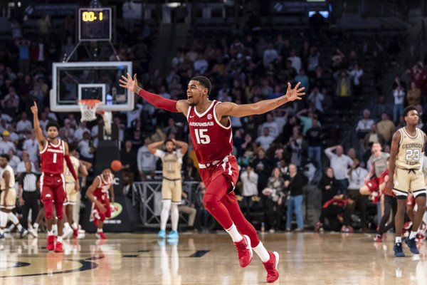 Arkansas junior guard Mason Jones celebrates after hitting the game-winning three-pointer in overtime against Georgia Tech at McCamish Pavilion in Atlanta. Jones led all scorers with 24 points as the Hogs improved to 6-0.