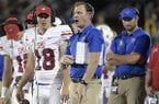 SMU offensive coordinator Rhett Lashlee, center, calls out instructions from the sideline during the first half of an NCAA college football game against Central Florida Saturday, Oct. 6, 2018, in Orlando, Fla. (AP Photo/Phelan M. Ebenhack)