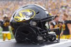 A Missouri football helmet sits on the bench during the third quarter of an NCAA college football game against South Carolina Saturday, Sept. 21, 2019, in Columbia, Mo. (AP Photo/L.G. Patterson)