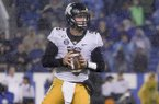 Missouri quarterback Taylor Powell (5) drops back to pass the ball during the NCAA college football game, Saturday, Oct. 26, 2019, in Lexington, Ky. (AP Photo/Bryan Woolston)