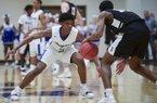 Bryant High School Khalen Robinson (2) covers Bentonville High School Connor Deffebaugh (10) during a basketball game, Saturday, March 2, 2019 at Bentonville West High School in Centerton.