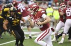 Arkansas quarterback Jack Lindsey runs the ball against Missouri during the first half of an NCAA college football game, Friday, Nov. 29, 2019 in Little Rock, Ark. (AP Photo/Michael Woods)