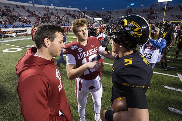 Former Arkansas quarterback Austin Allen (left), Arkansas quarterback Jack Lindsey (center) and Missouri quarterback Taylor Powell are shown following the Tigers' 24-14 victory over the Razorbacks on Friday, Nov. 29, 2019, in Little Rock.