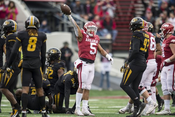 University of Arkansas running back Rakeem Boyd (5) celebrates a first down during the Battle Line Rivalry game against the University of Missouri Tigers at War Memorial Stadium in Little Rock on Friday November 29th 2019.