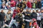 Missouri wide receiver Tauskie Dove (86) catches a pass under coverage by University of Arkansas defensive backs Jarques McClellion (4) and Micahh Smith (26) during the Battle Line Rivalry game at War Memorial Stadium in Little Rock on Friday November 29th 2019.