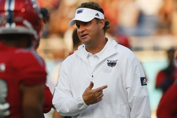 Florida Atlantic coach Lane Kiffin talks with players before an NCAA college football game against UCF on Saturday, Sept. 7, 2019, in Boca Raton, Fla. (AP Photo/Jim Rassol)