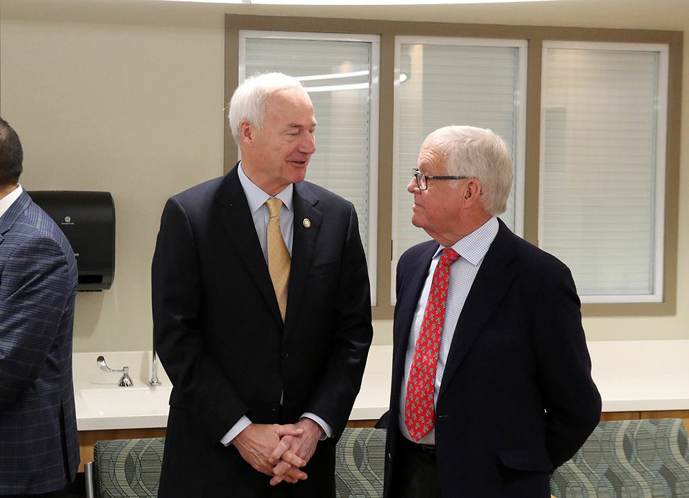 Gov. Asa Hutchinson, left, talks with John Ed Anthony at the grand opening of the new CHI St. Vincent Hot Springs Anthony Childbirth Center on Monday. Anthony attended as a representative of the Catherine Cooper Anthony Charitable Trust. - Photo by Richard Rasmussen of The Sentinel-Record