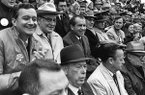 "President Richard M. Nixon, second row, second from left, watches ""The Big Shootout"" football game between Arkansas and Texas in the stands at Razorback Stadium in Fayetteville, Ark., in this December 6, 1969 file photo. Seated beside Nixon from left are Rep. John Paul Hammerschmidt, R-Ark., Ark. Gov. Winthrop Rockefeller, Sen. John L. McClellan, D-Ark., Sen. J. William Fulbright, D-Ark., Rep. George H. Bush, R-Tex., and on the first row, left, University of Arkansas President David W. Mullins. Then ranked No. 1 Texas won the game and the national championship by defeating No. 2 Arkansas 15-14. (AP Photo/White House via Special Collections, University of Arkansas Libraries, Fayetteville, File)"