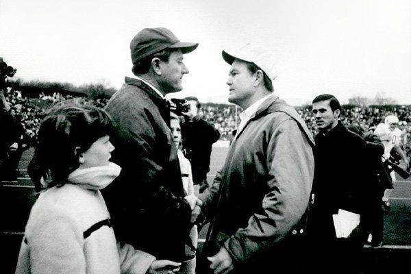 Arkansas football coach Frank Broyles, left, and Texas coach Darrell Royal greet on the field in Fayetteville, Ark., in this Dec. 6, 1969, file photo. No. 1 Texas defeated No. 2 Arkansas 15-14. (Arkansas Democrat-Gazette File)