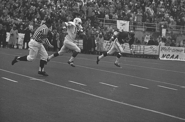 Texas quarterback James Street runs for a 42-yard touchdown during the fourth quarter of a game against Arkansas on Dec. 6, 1969, in Fayetteville. (Arkansas Democrat-Gazette File)