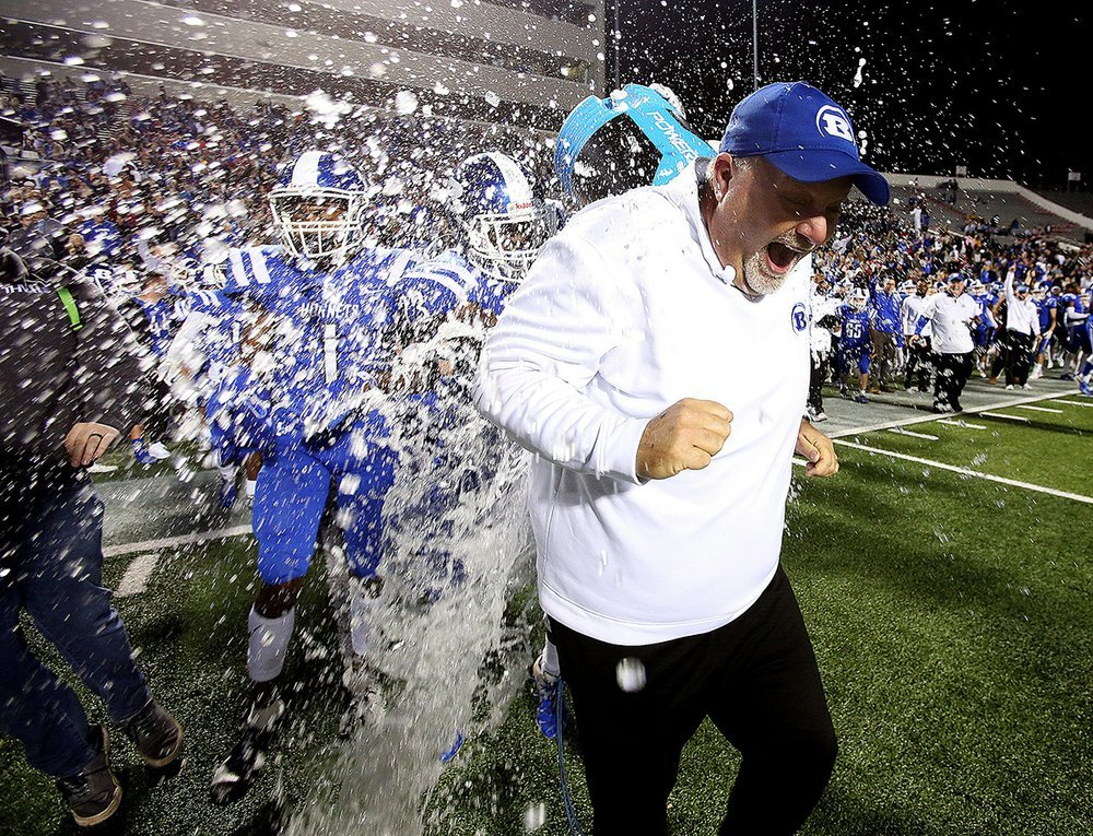 Bryant Coach Buck James is doused with ice water by players Kaleb Knox and Catrell Wallace after the Hornets won their second consecutive Class 7A state championship with a victory over North Little Rock on Friday night at War Memorial Stadium in Little Rock. More photos are available at arkansasonline.com/127nlrbryant.