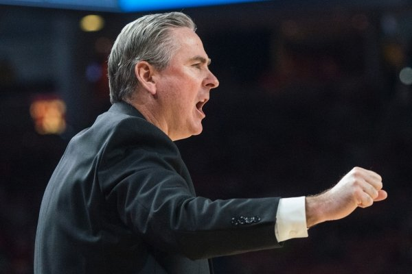 Rick Stansbury, Western Kentucky head coach, shouts directions to his team in the first half vs Arkansas Saturday, Dec. 8, 2018, at Bud Walton Arena in Fayetteville.