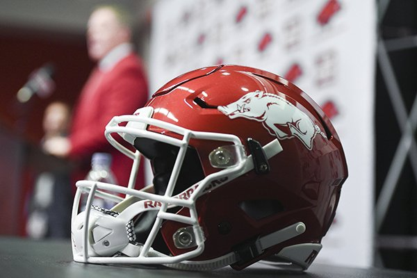 An Arkansas football helmet is shown as athletics director Hunter Yurachek during the introduction of new football coach Sam Pittman on Monday, Dec. 9, 2019, in Fayetteville.
