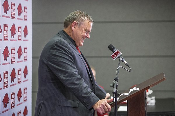 Arkansas coach Sam Pittman answers questions during a news conference Monday, Dec. 9, 2019, in Fayetteville.