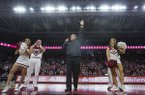 Arkansas football coach Sam Pittman (center) speaks to the crowd during a basketball game between Arkansas and Tulsa on Saturday, Dec. 14, 2019, at Bud Walton Arena in Fayetteville.