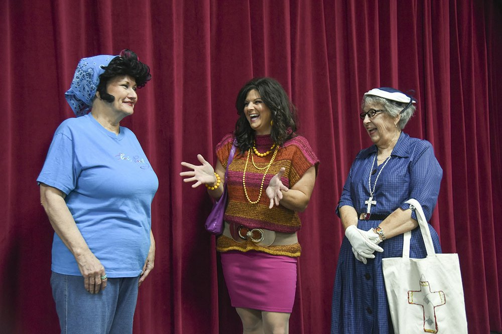 """Actors from the Pocket Community Theatre's production of """"Radio T.B.S. depict a scene from the play. - Photo by Grace Brown of the Sentinel-Record."""