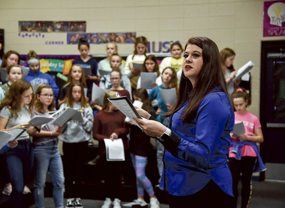 Lakeside Middle School choir teacher Amber Moss instructs her students. - Photo by Grace Brown of the Sentinel-Record.