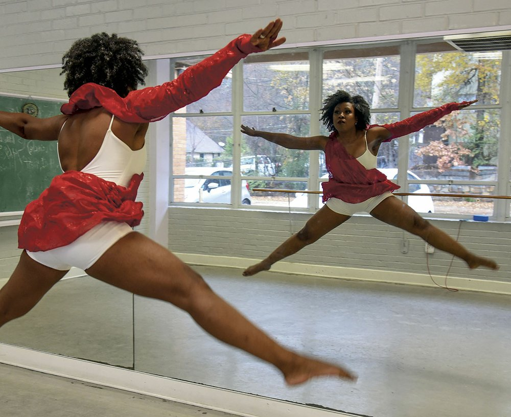 Sonja Littlejohn Barlow demonstrates a leap in the dance room of the Quapaw Community Center. - Photo by Grace Brown of the Sentinel-Record.