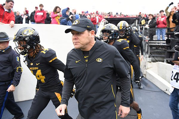 Missouri head coach Barry Odom leads his team onto the field to play Arkansas during an NCAA college football game, Friday, Nov. 29, 2019 in Little Rock. (AP Photo/Michael Woods)