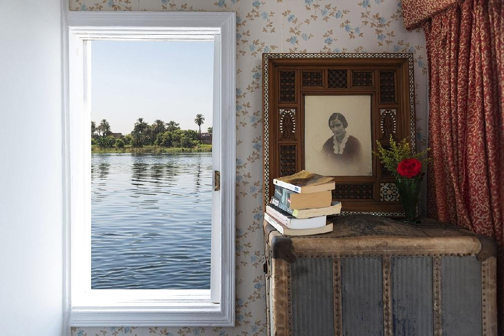 The Nile flows just beyond a bedroom window in the Egyptian vessel, the Orient, in Egypt on Sept. 24, 2019. In the late 1800s, women explorers sailed the Nile, sending back vivid accounts of Egypt's riches and a 21st-century writer travels in their wake. (Maria Mavropoulou/The New York Times)