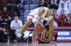 Indiana forward Justin Smith, left, recovers a loose ball in front of Arkansas guard Desi Sills in the second half of an NCAA college basketball game in Bloomington, Ind., Sunday, Dec. 29, 2019. Arkansas won 71-64. (AP Photo/AJ Mast)