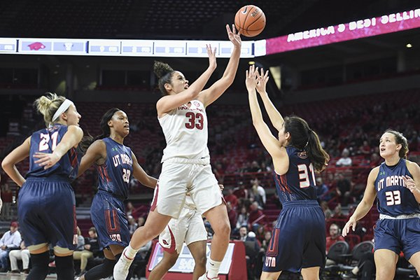 Arkansas guard Chelsea Dungee (33) shoots over Tennessee-Martin defenders Sunday, Dec. 29, 2019, during a game at Bud Walton Arena in Fayetteville.