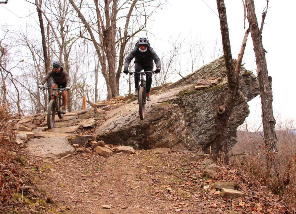 Mike Colombo taking the high line while Eddie Campoman takes the low on the new BOC Trail System at Buffalo Outdoor Center at Ponca. (Special to the Democrat-Gazette/Bob Robinson)