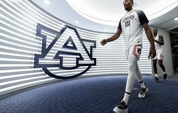 Auburn forward Anfernee McLemore (24) walks in from warmups before the first half of an NCAA college basketball game against Lipscomb, Sunday, Dec. 29, 2019, in Auburn, Ala. (AP Photo/Julie Bennett)