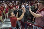 Eric Musselman, Arkansas head coach, high-fives students after Arkansas beat Tulsa 98-79 Saturday, Dec. 14, 2019, at Walton Arena in Fayetteville. The Razorbacks will be back at Bud Walton Arena for the first time in three weeks when they play Texas A&M to open conference play.