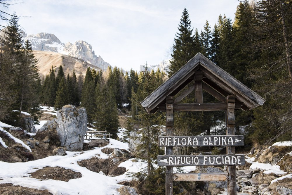 Signs point the way to various alpine inns in the Dolomite Range of northeastern Italy. The inns provide refuge for skiers on a ski safari through the region.