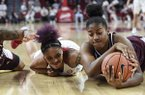 Arkansas forward Kiara Williams (left) and Texas A&M center Ciera Johnson (right) dive for a loose ball during a game Thursday, Jan. 2, 2020, in Fayetteville.