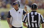 Auburn head coach Gus Malzahn question a touchdown by Minnesota with line judge Jim Slayton during the first half of the Outback Bowl NCAA college football game Wednesday, Jan. 1, 2020, in Tampa, Fla. (AP Photo/Chris O'Meara)