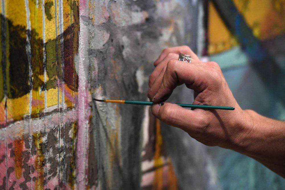 NWA Democrat-Gazette/J.T. WAMPLER Jody Travis Thompson of Fayetteville paints Thursday Oct. 17, 2019 in his studio at the Mount Sequoyah Center in Fayetteville.