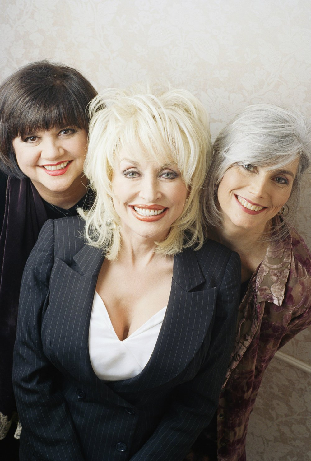Singers Linda Ronstadt (from left) Dolly Parton and Emmylou Harris pose in New York, Feb. 11, 1999. Together, they were the supergroup Trio, and this photo was taken at the release of their second album together, Trio II. (AP Photo/Jim Cooper)